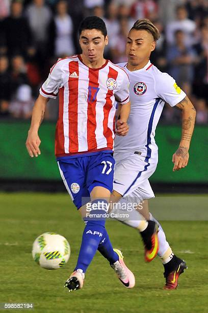 Eduardo Vargas of Chile battles for the ball with Miguel Almiron of Paraguay during a match between Paraguay and Chile as part of FIFA 2018 World Cup...