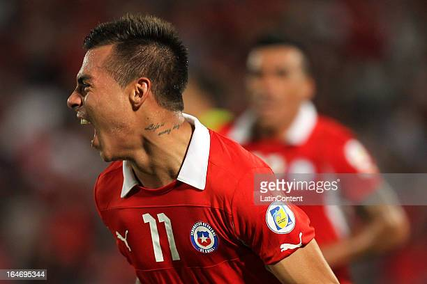 Eduardo Vargas of Chile celebrates a goal during a match between Chile and Uruguay as part of the 12th round of the South American Qualifiers for the...