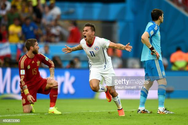 Eduardo Vargas of Chile celebrates after scoring the team's first goal during the 2014 FIFA World Cup Brazil Group B match between Spain and Chile at...