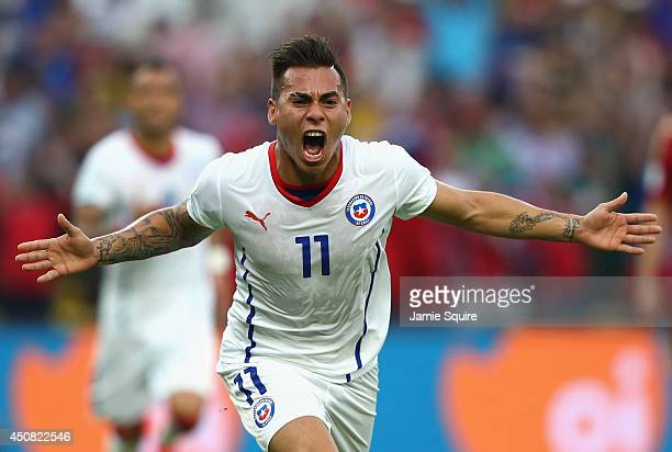 Eduardo Vargas of Chile celebrates scoring his team's first goal during the 2014 FIFA World Cup Brazil Group B match between Spain and Chile at...