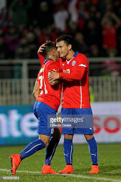 Eduardo Vargas of Chile celebrates with Charles Aranguiz the first goal of Chile during the international friendly match between Chile and Northern...