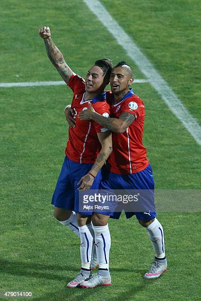 Eduardo Vargas of Chile celebrates with teammate Arturo Vidal after scoring the second goal of his team during the 2015 Copa America Chile Semi Final...