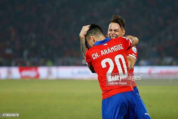Eduardo Vargas of Chile celebrates with teammate Charles Aranguiz after scoring the opening goal during the 2015 Copa America Chile Semi Final match...