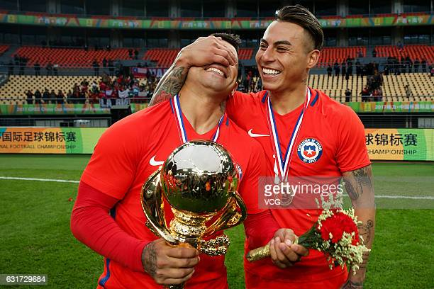 Eduardo Vargas of Chile celebrates with teammate during the awards ceremony after winning the final match against Iceland during 2017 Gree China Cup...