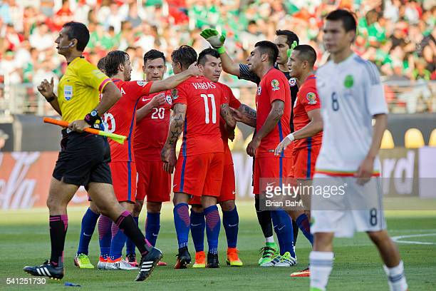 Eduardo Vargas of Chile celebrates with teammates after scoring during a Quarterfinal match between Mexico and Chile at Levi's Stadium as part of...