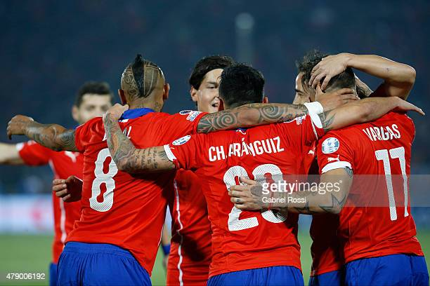 Eduardo Vargas of Chile celebrates with teammates after scoring the opening goal during the 2015 Copa America Chile Semi Final match between Chile...