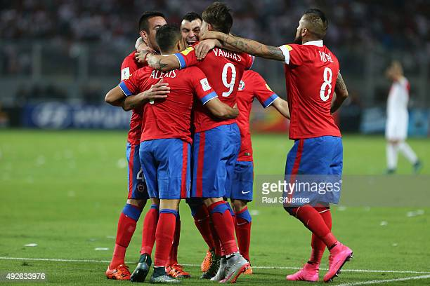 Eduardo Vargas of Chile celebrates with teammates after scoring the fourth goal against Peru during a match between Peru and Chile as part of FIFA...