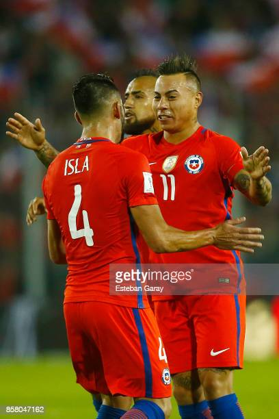 Eduardo Vargas of Chile celebrates with teammates after scoring the first goal of his team during a match between Chile and Ecuador as a part of FIFA...