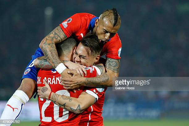Eduardo Vargas of Chile celebrates with teammates Arturo Vidal and Charles Aranguiz after scoring the opening goal during the 2015 Copa America Chile...