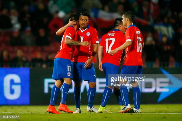 Eduardo Vargas of Chile celebrates with teammates the third goal of his team during the international friendly match between Chile and Egypt at...