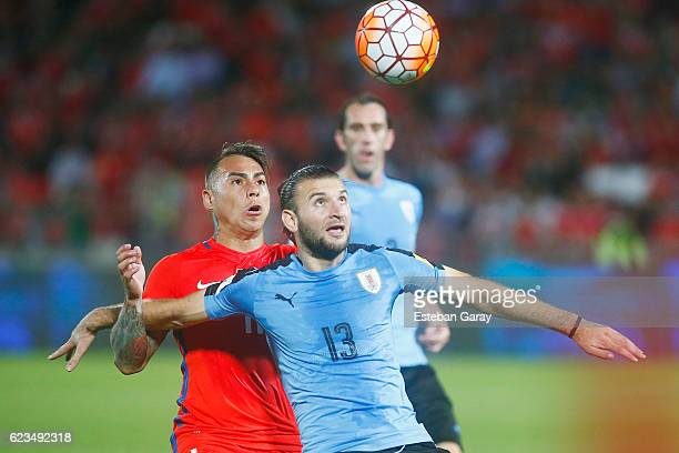 Eduardo Vargas of Chile fights for the ball with Gaston Silva of Uruguay during a match between Chile and Uruguay as part of FIFA 2018 World Cup...