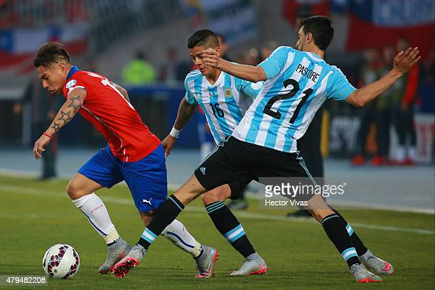 Eduardo Vargas of Chile fights for the ball with Javier Pastore of Argentina during the 2015 Copa America Chile Final match between Chile and...