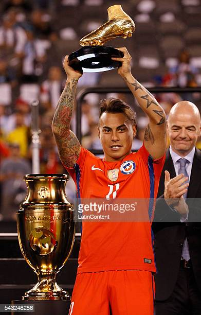 Eduardo Vargas of Chile holds up the Golden Boot Award following the championship match between Argentina and Chile at MetLife Stadium as part of...