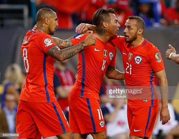 Eduardo Vargas of Chile is congratulated by teammates Arturo Vidal and Marcelo Diaz after scoring a goal in the first half against Panama during the...