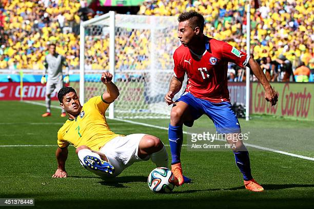 Eduardo Vargas of Chile is tackled by Hulk of Brazil during the 2014 FIFA World Cup Brazil Round of 16 match between Brazil and Chile at Estadio...
