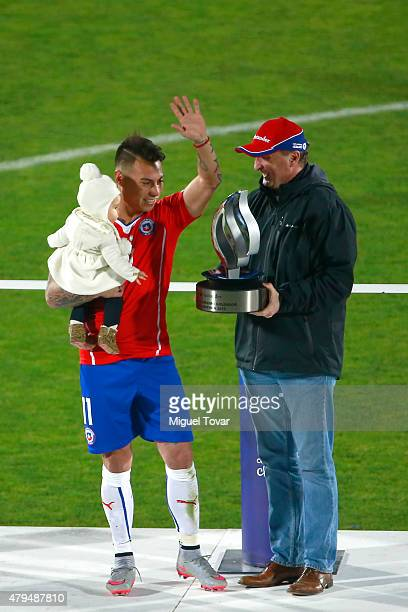 Eduardo Vargas of Chile receives the striker award shared with Paolo Guerrero of Peru the 2015 Copa America Chile Final match between Chile and...