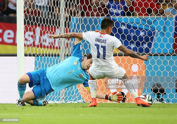 Eduardo Vargas of Chile scores a goal beating goalkeeper Iker Casillas of Spain during the 2014 FIFA World Cup Brazil Group B match between Spain and...