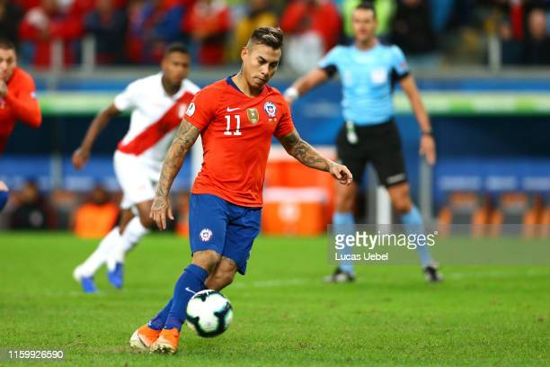 Eduardo Vargas of Chile takes a penalty kick during the Copa America Brazil 2019 Semi Final match between Chile and Peru at Arena do Gremio on July...