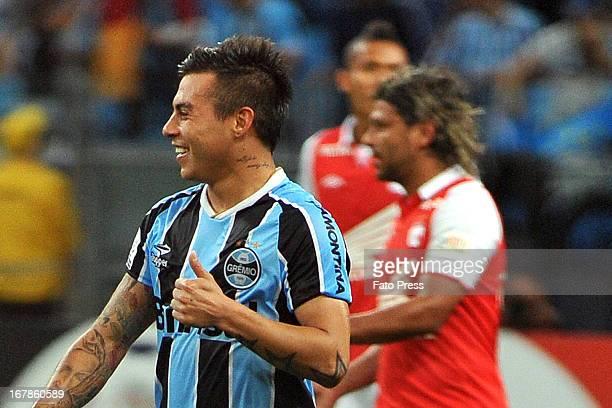 Eduardo Vargas of Gremio celebrates a goal during a match between Gremio and Independiente Santa Fe as part of the Copa Bridgestone Libertadores 2013...