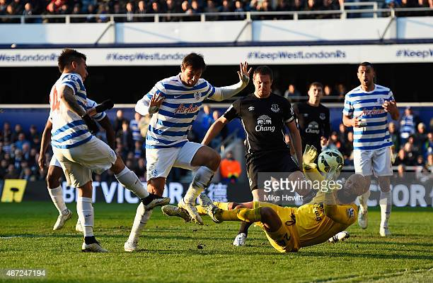 Eduardo Vargas of QPR scores his equalising goal past Tim Howard of Everton during the Barclays Premier League match between Queens Park Rangers and...