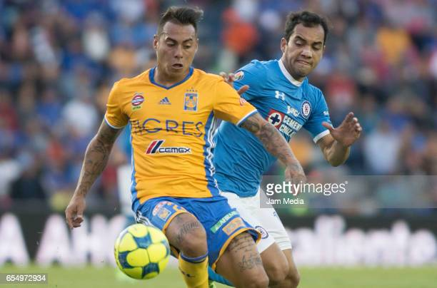 Eduardo Vargas of Tigres and Adrian Aldrete of Cruz Azul fight for the ball during the 11th round match between Cruz Azul and Tigres UANL as part of...
