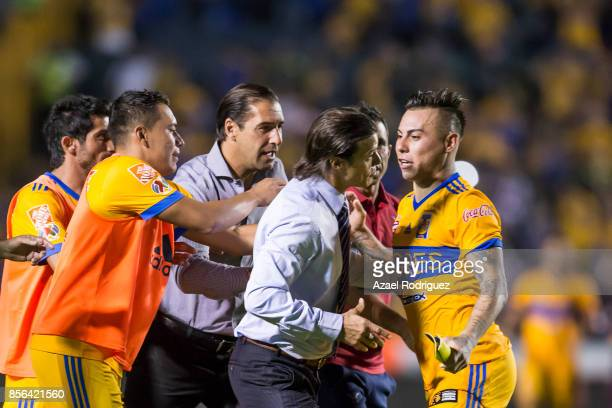 Eduardo Vargas of Tigres argues with Matias Almeyda coach of Chivas at the end of the 12th round match between Tigres UANL and Chivas as part of the...