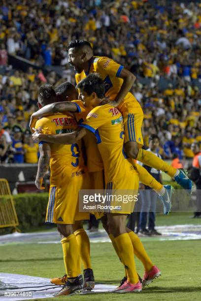 Eduardo Vargas of Tigres celebrates with teamates after scoring his team's second goal during the seventh round match between Tigres UANL and Lobos...