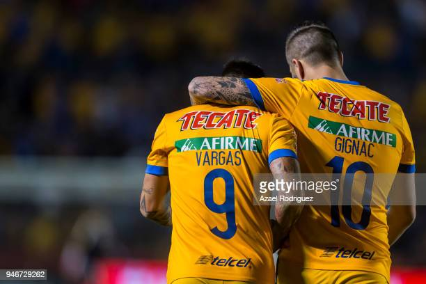 Eduardo Vargas of Tigres celebrates with teammate AndrePierre Gignac after scoring his team's second goal during the 15th round match between Tigres...