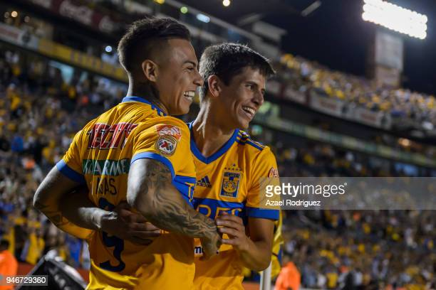 Eduardo Vargas of Tigres celebrates with teammate Jurgen Damm after scoring his team's second goal during the 15th round match between Tigres UANL...