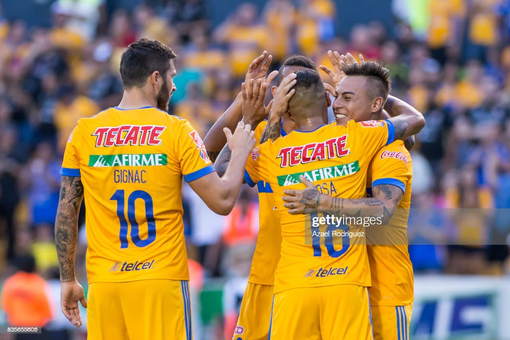Eduardo Vargas of Tigres celebrates with teammates after scoring his team's first goal during the 5th round match between Tigres and Pumas as part of the Torneo Apertura 2017 Liga MX at Universitario Stadium on August 19, 2017 in Monterrey, Mexico.