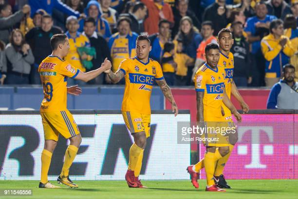Eduardo Vargas of Tigres celebrates with teammates after scoring his team's first goal during the 4th round match between Tigres UANL and Pachuca as...