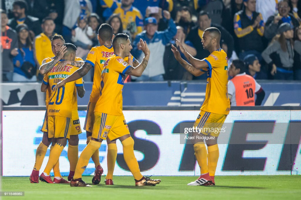 Eduardo Vargas of Tigres celebrates with teammates after scoring his team's first goal during the 4th round match between Tigres UANL and Pachuca as part of the Torneo Clausura 2018 Liga MX on January 27, 2018 in Monterrey, Mexico.