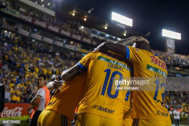 Eduardo Vargas of Tigres celebrates with teammates after scoring his team's second goal during the 15th round match between Tigres UANL and Cruz Azul...