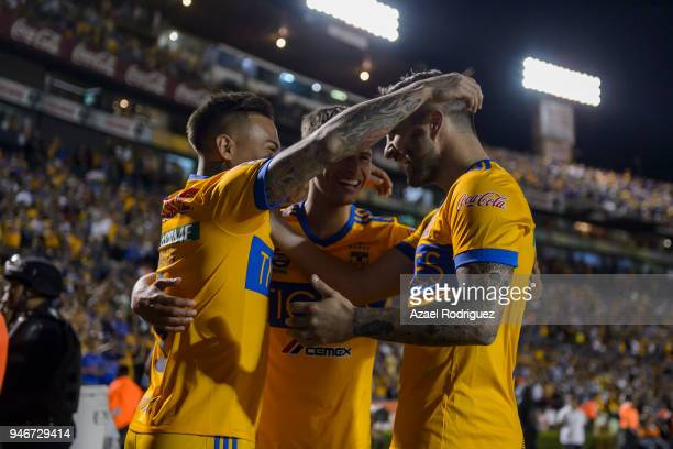 "Eduardo Vargas of Tigres celebrates with teammates Jurgen Damm and Andre-Pierre Gignac after scoring his team""u2019s second goal during the 15th..."