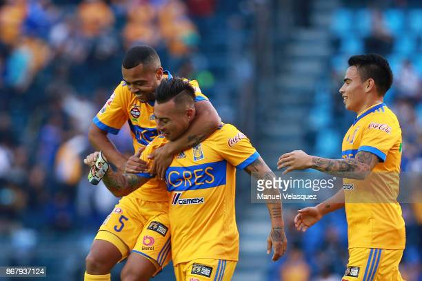 Eduardo Vargas of Tigres celebrates with teammates Rafael de Souza and Lucas Zelarayan after scoring his team's second goal during the 15th round...