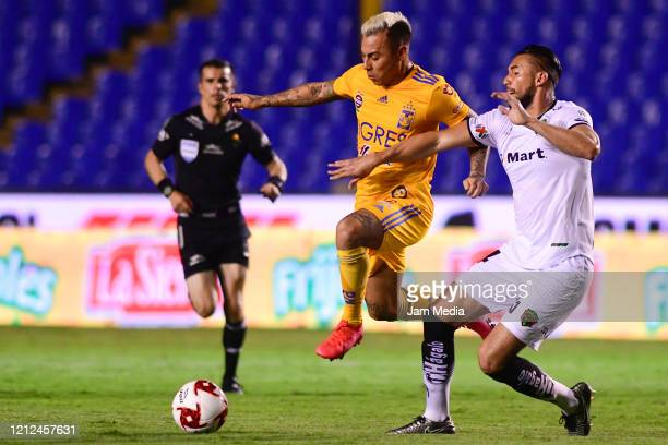 Eduardo Vargas of Tigres fights for the ball with Elio Castro of Juarez during the 10th round match between Tigres UANL and FC Juarez as part of the...