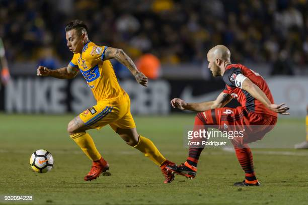 Eduardo Vargas of Tigres fights for the ball with Michael Bradley of Toronto during the quarterfinals second leg match between Tigres UANL and...