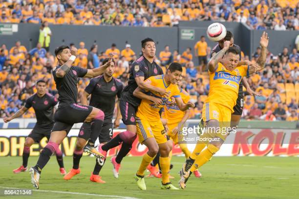 Eduardo Vargas of Tigres heads a corner with Edwin Hernandez of Chivas during the 12th round match between Tigres UANL and Chivas as part of the...