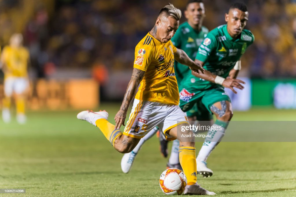 5f465fe9eef Eduardo Vargas of Tigres kicks the ball while is observed by William ...