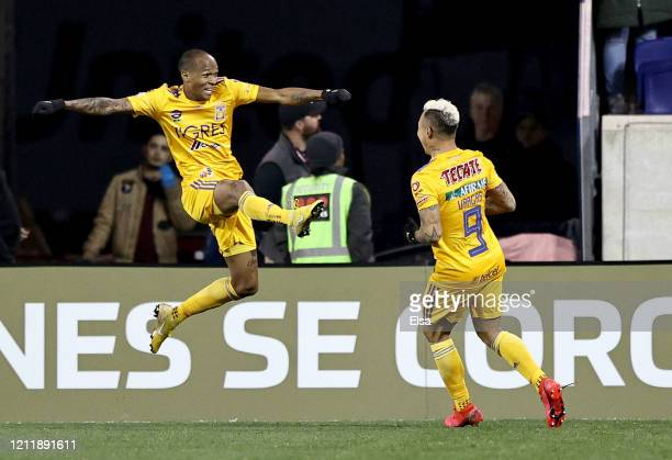 Eduardo Vargas of UANL Tigres celebrates his goal with teammate Luis Quinones in the second half against the New York City FC during Leg 1 of the...