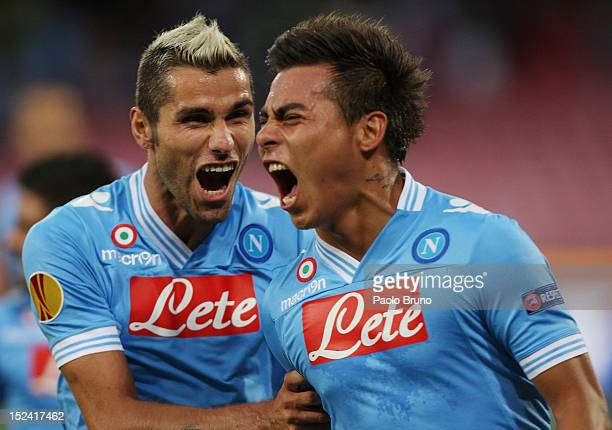 Eduardo Vargas with his teammate Valon Behrami of SSC Napoli celebrate after scoring the opening goal during the UEFA Europa League group F match...