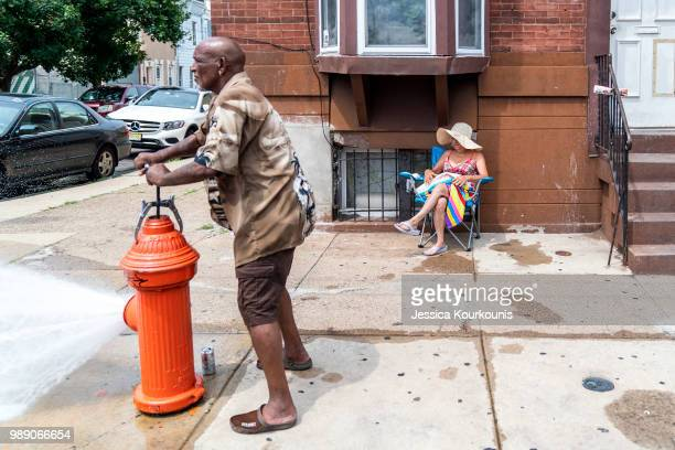 Eduardo Velev opens a fire hydrant during a heatwave on July 1 2018 in Philadelphia Pennsylvania An excessive heat warning has been issued in...