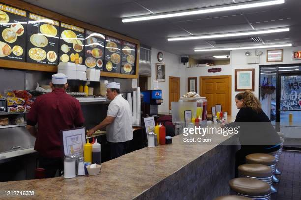 Eduardo Villobos and Bill Rangal prepares breakfast for customers at Don's Grill in the Pilsen neighborhood on March 16 2020 in Chicago Illinois...