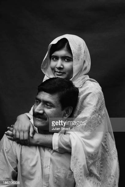 Education activist Malala Yousafzai is photographed with her father Ziauddin Malala for People magazine on August 30 2013 in Birmingham England