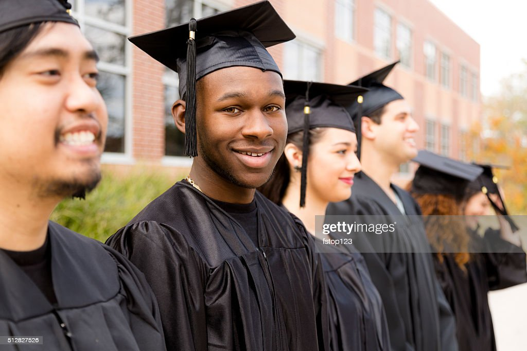 Education: African descent male graduate and friends on college campus. : Stock Photo