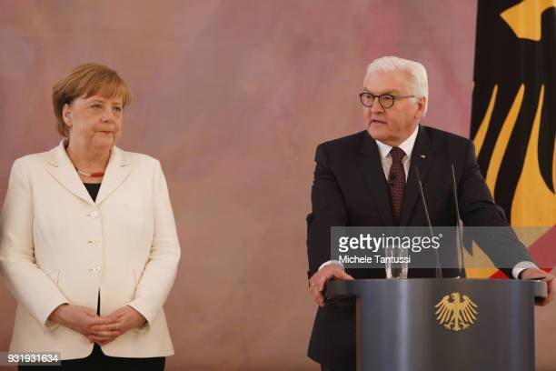 Education and Germany Chancellor Angela Merkel listens to Germany President FrankWalter Steinmeier as she takes her oath to serve as Chancellor...