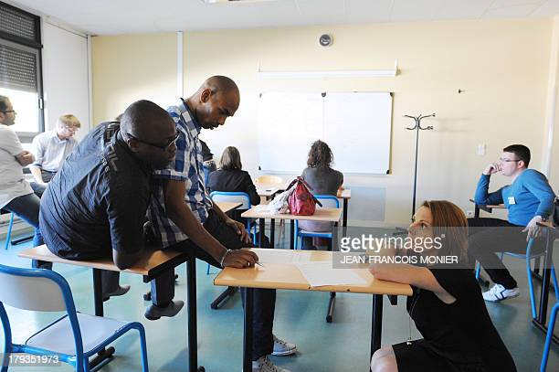 Education Assistants set their schedule in a classroom on the eve of the new school year on September 2 in the professional Lycee Henri...