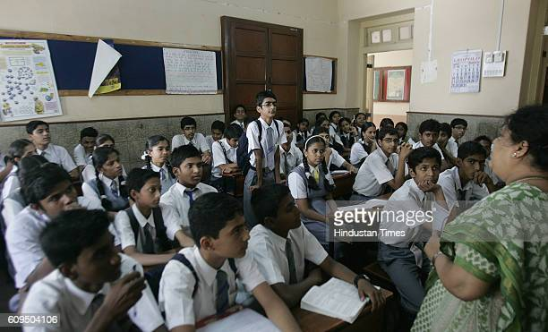 Education Classroom Teacher 9th standard school students studying in classroom at Holy Name School Colaba Mumbai