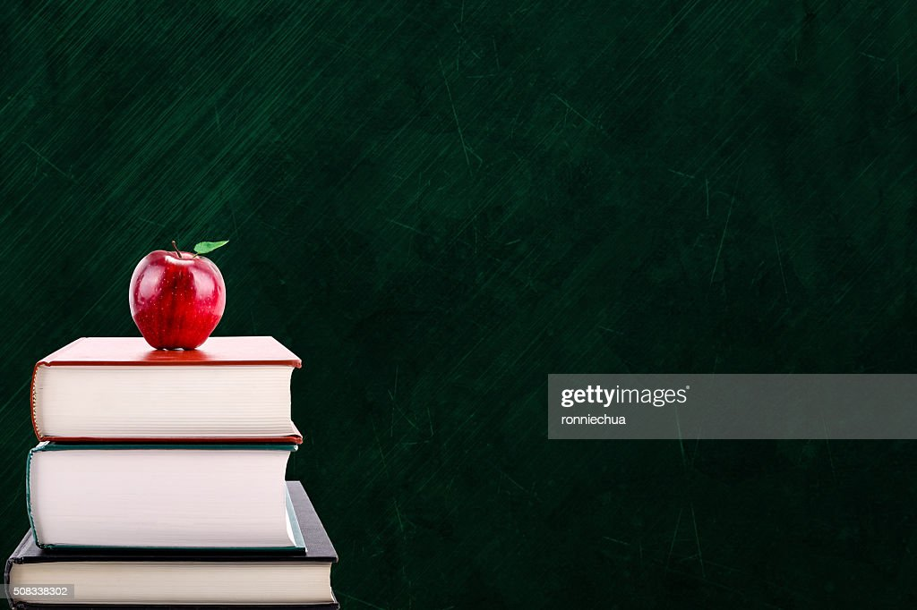 Education Concept With Apple On Books And Chalkboard Background Stock Photo