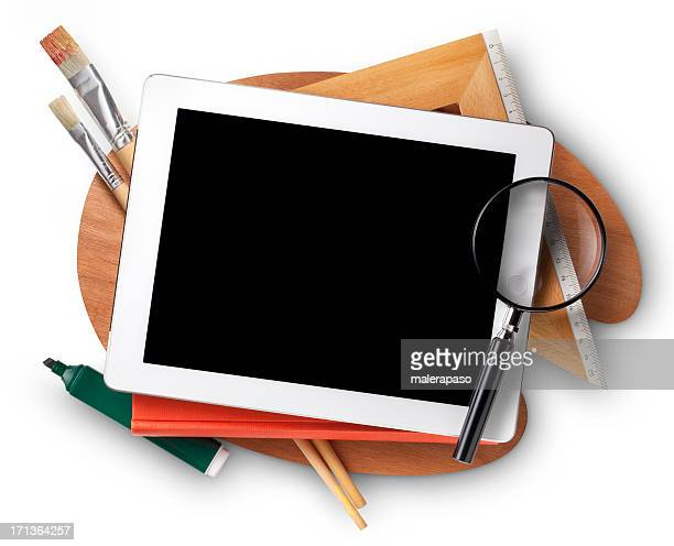 Education. Digital tablet with school supplies.